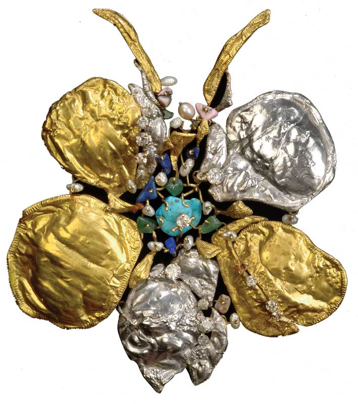 Flower of Eden, gold, platino and stones.