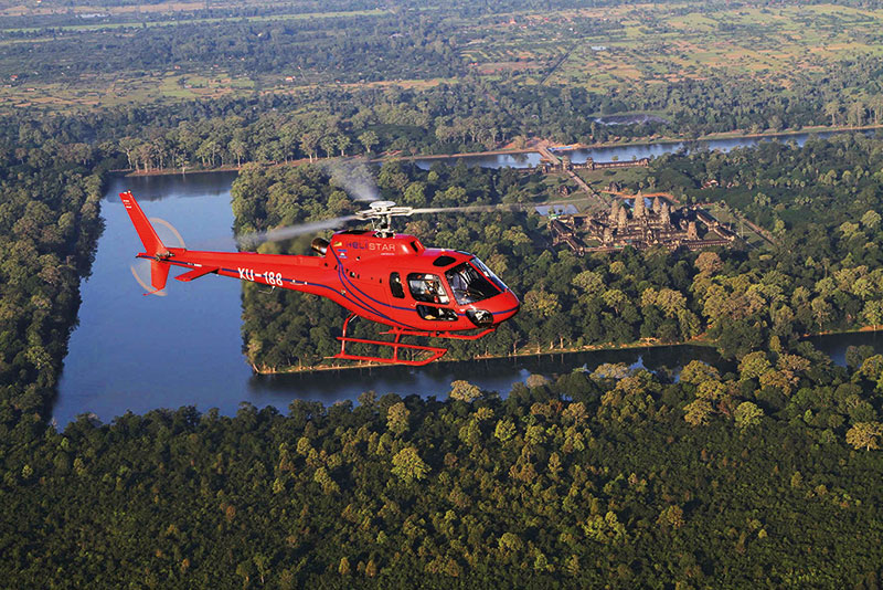 Amura, Camboya, Cambodia, Helicopter services include flying over the ruins of Angkor.